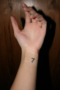 7 tattoo. // exactly the spot and size I want it.
