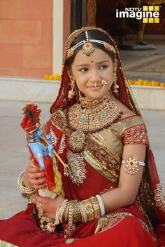 A graceful Indian Child Artist, dressed up as the young Princess Meera (better known as Saint Meera for her love of Hindu Diety Lord Krishna)