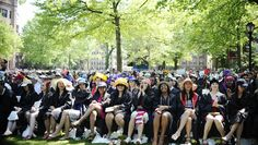 Students wear creative hats during Class Day at Yale University, Sunday, May 17, 2015, in New Haven, Conn. Vice President Joe Biden spoke at Class Day, urging graduating students to question the judgment of others, but not their motives to build consensus. (AP Photo/Jessica Hill)