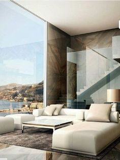 Elegant simplicity with a stunning view from 'open' living room. // Elegante Schlichtheit und ein beeindruckender Ausblick vom offenen gestalteten Wohnbereich aus. #ModernInterior #Interior #Architecture #enjoysiemens