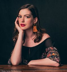 Film fest: Anne Hathaway looked stylish as she posed for some portraits at the Toronto Film Festival on Friday