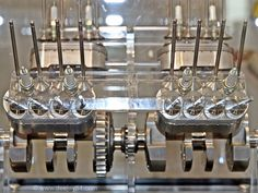 500cc V4 Oval Pistons 8 Valves/Cyl 19,000 rpm. Acrylic glass on top & we got a table.