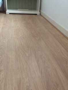 Light varnished Oak Effect laminate flooring laid in an East London flat. www.ppmsltd.co.uk