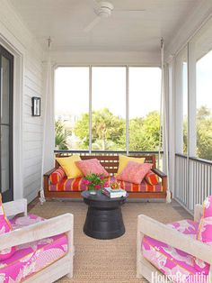"""A screened porch in a Sullivan's Island, South Carolina, house is collaged in bright outdoor fabrics.  """"In my houses, I tend to make a base of neutrals, and I love using small amounts of color for contrast,"""" designer Sally Markham says. """"But the client urged me to use brighter colors than I normally would have, and I'm glad she did. They add excitement.""""   - HouseBeautiful.com"""