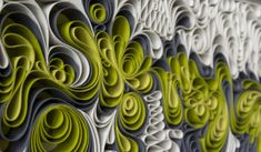 Amazing art using canvas in a sort of quilling method to tell a story about depth and color.