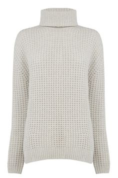 This chunky oversized jumper features a polo neck, long sleeves and an all-over cable design. Length of jumper, from shoulder seam to hem, 67cm approx. Height of model shown: 5ft 10 inches/178cm. Model wears: UK size 10.Fabric: Main: 45.0% Wool