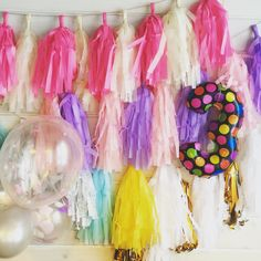Tassel garland, foil balloon number 3, balloons with confetti.