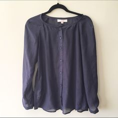 """LOFT Navy Sheer Blouse LOFT navy blue sheer button down blouse. Long sleeved. Only worn once, excellent condition. Measures 26"""" shoulder to bottom, 17"""" arm to arm. Size XS. 100% polyester. Reasonable offers welcome! Bundle discount available!(20% off 3+ items) No trades/off Posh transactions/modeling LOFT Tops Blouses"""