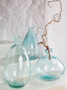 Reminiscent of something kept on your grandma's shelf, our stunning large bottle vase has been crafted using recycled glass. Small Glass Vases, Glass Jars, Clear Glass, Bottles And Jars, Wine Glass, Antique Glass Bottles, Recycled Glass Bottles, Vintage Bottles, Deco Design