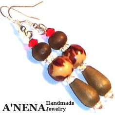 "Women's Earrings:  ""I Am Properously Successful"" are made of two types of swarovski crystals(clear and cherry red) three types of wood( dark, meduim and blonde and medium wood)  Speedy delivery,excellent customer service and quality materials.  Now available in Clip-on  http://www.etsy.com/shop/ANenaJewelry.   Free set of earring stoppers will be included with your order.Let A'Nena Handmade Jewelry make you into fall ""in love"" with earrings! $27.77"