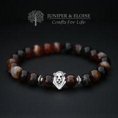 Check out this item in my Etsy shop https://www.etsy.com/listing/221780143/lion-bracelet-mens-stretch-bracelet