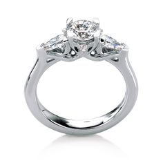 Scotasay engagement ring by MaeVona: Round brilliant-cut engagement ring with pear-shape accents. Elegant, neatly balanced design. The round center stone is complemented by four pear-shape diamonds; two on the sides of the center stone, and two more on the sides of the setting. Named after the Scottish island of Scotasay.