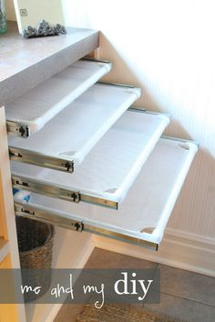 Create pull-out drying racks. - WomansDay.com
