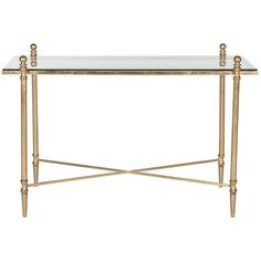 Anchor the living room with this lovely iron coffee table, showcasing a glass top and gold-hued finish. Product: Coffee table