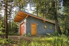 Whoa!  How great would this be!  I would have to have a screen door.  And a pet door.  Mazama Cabin - contemporary - garage and shed - seattle - Lawrence Architecture
