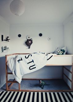 A bit lofted makes a custom kids bed more fun and easier to tuck them in at night.  Black and white feels anything but dull here.
