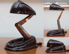 Jumo Cie bakelite table lamp, made by La Societe Jumo, France 1940s. Bakelite, chrome, copper. H 47 cm when opened, 12.7 cm closed. Base 20.3 x 28 cm.
