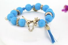 $2.4  Fashion Blue Resin Beads All-match Alloy Leopard Pendant Design Elastic Bracelet Jewelry Gift  http://www.eozy.com/fashion-blue-resin-beads-all-match-alloy-leopard-pendant-design-elastic-bracelet-jewelry-gift.html