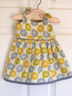 Infant dress.  Pattern {free}- Itty Bitty Dress from Made by Rae,  Fabric- Denyse Schmidt's Aunt Edna
