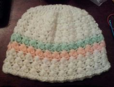 Crocheted baby hat with criss cross puff stitch