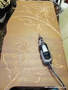 Using A Dremel To Carve Designs Into Wooden Furniture That Is Already Scuffed Or Damaged That You Find For Cheap At Thrift Or Yard Sale! Imagine If You Burned Inside The Cuts?! Then Finished It?!  Could Be Really Cool!!!