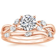 This ring is both an engagement ring and a wedding band (the wedding band is detachable) and perfectly incorporates the number three, signifying us and God and how it's His love that binds us. 14K Rose Gold Willow Diamond Ring from Brilliant Earth