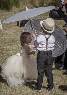 Flower girl tutu vintage chic page boy suspenders converse parasols outdoor wedding