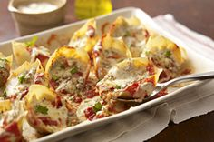Mmm… This creamy pesto stuffed pasta shells recipe will be a hit at your next get-together!