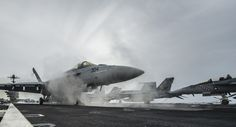 WATERS SOUTH OF JAPAN (May 23, 2015) An F/A-18E Super Hornet attached to the Eagles of Strike Fighter Squadron (VFA) 115 launches from the flight deck of the Nimitz-class aircraft carrier USS George Washington (CVN 73). George Washington and its embarked air wing, Carrier Air Wing (CVW) 5, are on patrol in the U.S. 7th Fleet area of responsibility supporting security and stability in the Indo-Asia-Pacific region. (U.S. Navy photo by Mass Communication Specialist 3rd Class Chris…