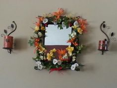 Mirror decorated with artificial flowers