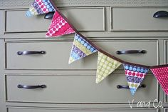 A tutorial for a pennant style banner using up your scraps