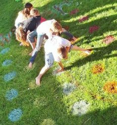 A grass Twister board would be so, so fun for summer. According to this post, the spray paint used stays for two weeks until it gets grown out, and it doesn't hurt the grass. According to this post. Haha.