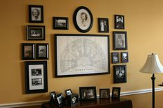 Family History wall - a large family tree fan in the center surrounded by old photographs - I love this idea!