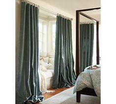 Long, luxurious, slightly puddled heavy velvet drapes when I want privacy.  Ivory, I'm thinking.