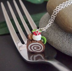 Check out this item in my Etsy shop https://www.etsy.com/listing/187886567/chocolate-swiss-roll-cake-necklace-log
