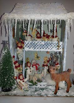 Escena de Navidad con muñecos de porcelana escala 1/12 realizada en el taller TM.