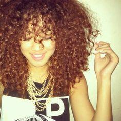 long curly kinky red brown hair