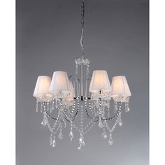 @Overstock.com - Warehouse of Tiffany Eros White Chandelier - Add elegance to any space with this Warehouse of Tiffany chandelier. This fixture has six lights topped by delicate white shades, while cascading crystals reflect light throughout the room. The metal details put the finishing touches on luxurious style.  http://www.overstock.com/Home-Garden/Warehouse-of-Tiffany-Eros-White-Chandelier/7888147/product.html?CID=214117 $148.99