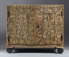 MUGHAL CARVED IVORY AND TORTOISESHELL VENEERED CABINET, 17TH CENTURY