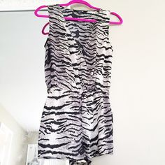 Black, White and Grey Romper/Jumpsuit This cute animal design romper is adorable. In perfect condition, like new. Fits true to size . Forever 21 Dresses