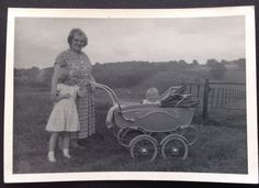 Old Black And White Photo Of Woman, Child And Baby In Old Pram