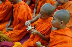 A young Indian Buddhist monk opens the petals of a lotus flower as he sits with others while offering prayers on the occasion of Buddha Purnima in Bangalore, during the Buddha Jayanthi or birth celebrations of Buddha. Today In Pictures, Cool Pictures, Offering Prayer, Birth Celebration, Guardian Uk, Lotus Position, Picture Editor, Buddhist Monk, S Pic