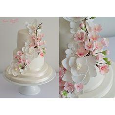 Cherry blossom and magnolia #fbf #sugarruffles #sugarrufflescakes #cake #wedding #sugarflowers #wedding #weddingcake #instafood by sugarruffles