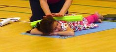 Kids love it! Therapy balls work well too. One more use for a pool noodle! The deep touch pressure is calming.---I use a big yoga ball, and our big blue mat.