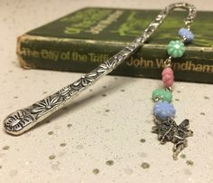 Flower fairy silver bookmark £7.50 Pastel Shades, Organza Gift Bags, Beaded Flowers, Bookmarks, Silver Plate, Turquoise Necklace, Arrow Necklace, Fairy, Butterfly
