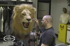 Character Creator John Cherevka airbrushes the nearly complete Stan Winston Studio lion animatronic puppet used in Tim Burton's BIG FISH.
