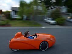 Velomobiles are reclining bicycles with fiberglass shells on top. Goes 80mi on 6 cents electricity $9,000