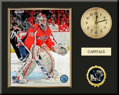 One 8 x 10 inch Washington Capitals photo of Braden  Holtbyinserted in a gold slide-in frame and mounted on a 12 x 15 inch solid black finish plaque.  Also features a 3-inch Arabian gold-faced clock, a customizable nameplate* and a 2-inch hockey medallion with a gold base. $59.99            @ ArtandMore.com