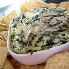 "Artichoke & Spinach Dip Restaurant Style | ""This dip was superb! It hit the spot with my out of town guest last week. I did stir my ingredients instead of layering them. And served the dip in a hollowed out Sour Dough Loaf with Blue Corn Chips. This one is a winner. Thanks for sharing."""
