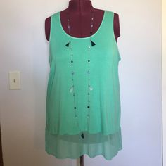 "Lane Bryant Aquamarine Racerback High-Low Tank Top Up for grabs is this top from Lane Bryant. It is a size 22/24 and measures 31.75"" from shoulder to hem in the front, 35"" in the back and has a 52"" bust. This tank top is a hi-low style with a racerback in aquamarine blue. It has a scoop neckline with a wide sheer hemline. This shirt has been worn once and is in terrific condition. Lane Bryant Tops Tank Tops"